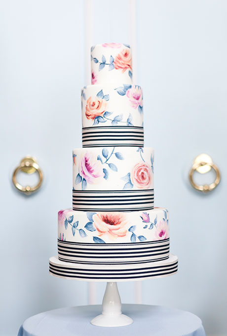 Cake designers Allyson Bobbitt and Sarah Bell hand painted a romantic floral pattern and added a graphic black-and-white stripe for a modern touch.