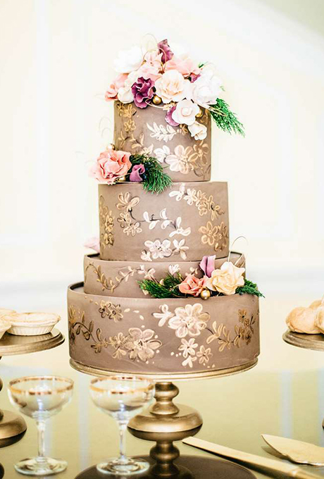 The hand-painted floral pattern and gumpaste blossoms on this taupe-and-gold confection from Sky's the Limit Cakes were inspired by 19th century china patterns.