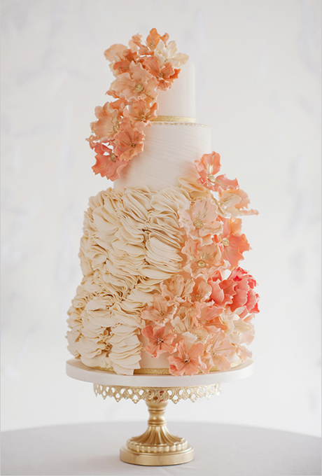 Jennifer Prinz of City View Bakehouse was sketching ideas for her next cake, what came to mind was an image of a glamorous wedding gown with tiers of ruffles on the skirt. She transformed the sketch into reality: sugar poppies in shades of peach, gold, and ivory,