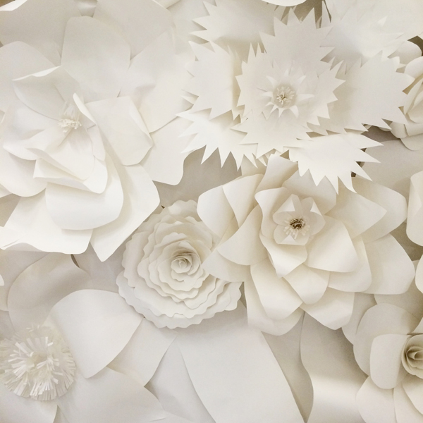 Our first show during day two was Watters, and while we're saving the gowns until next week, we had to share the runway's backdrop! The flowers were made out of paper – so cool to see up close, and they could definitely double as ceremony or reception décor.