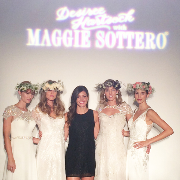The woman wearing the beautiful statement necklace is Keija Minor, the Editor in Chief of Brides, and Desiree Hartsock from The Bachelorette was also on hand debuting her new collection at the Maggie Sottero show.