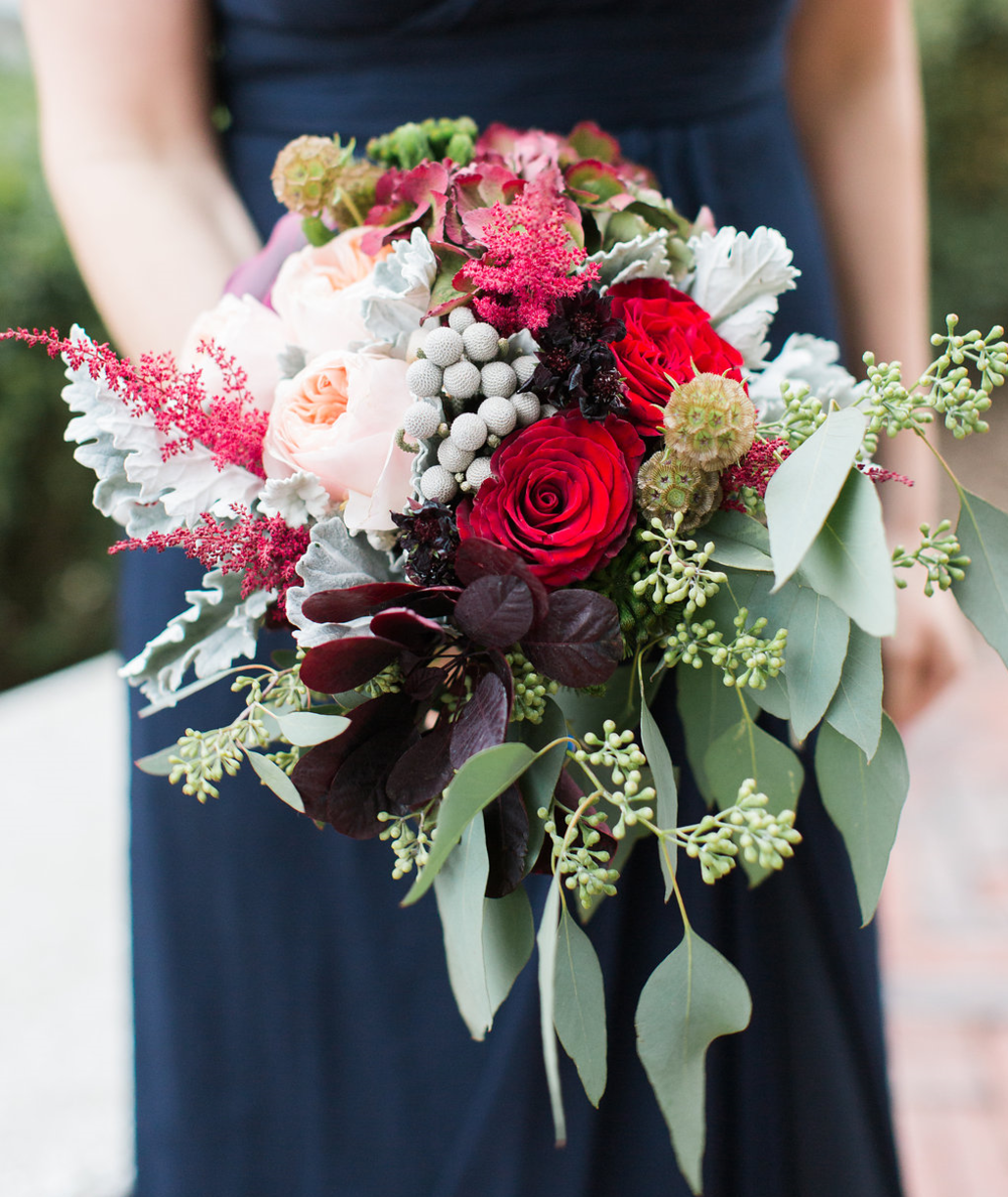 The bridesmaids bouquets included seasonal blooms of pepperberry, garden roses, scabiosa, cosmos, amaranthus and touches of seeded eucalyptus.