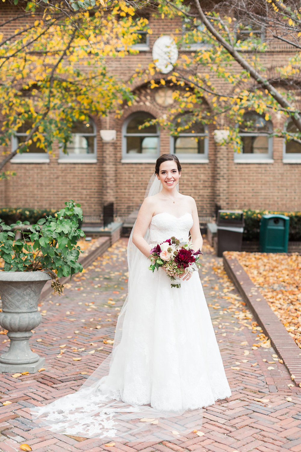 Elizabeth wore a stunning Monique Lhuillier gown from The Wedding Shoppe. Her bouquet from Evantine Design was filled with dahlias, garden roses, dusty miller, ranunculus and chocolate cosmos.