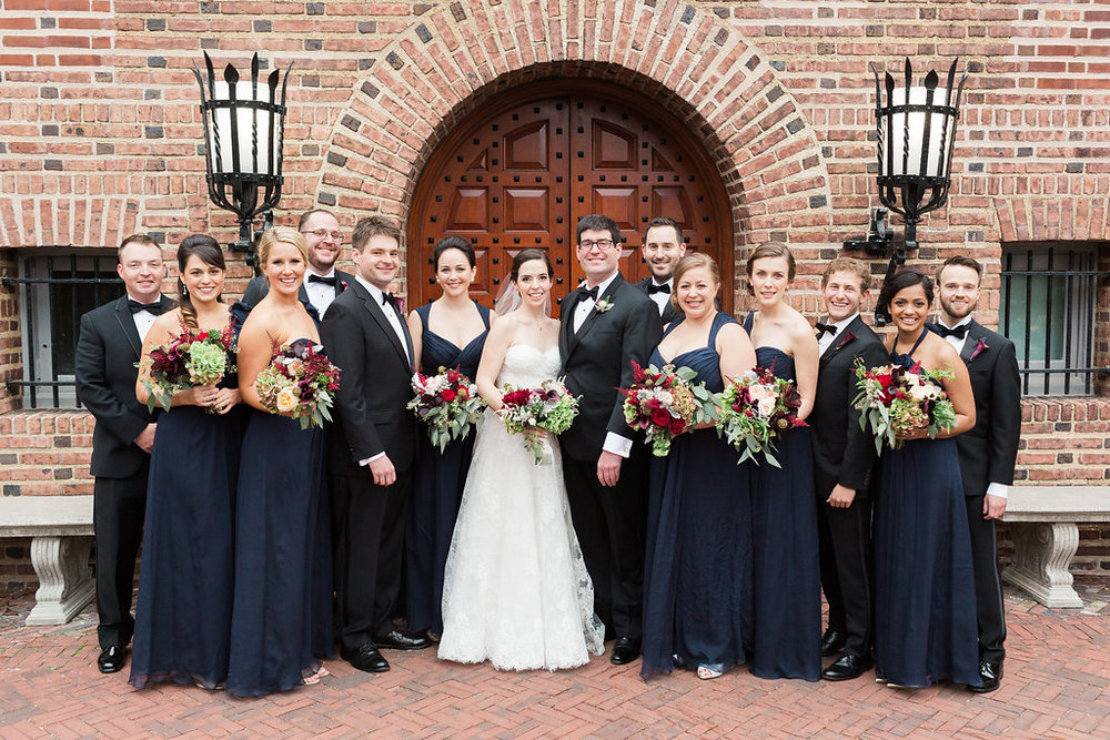 The bridesmaids wore crinkled chiffon midnight blue dresses from Amsale while the groomsmen all wore tuxedos with a simple miniature plum calla lily boutonniere.