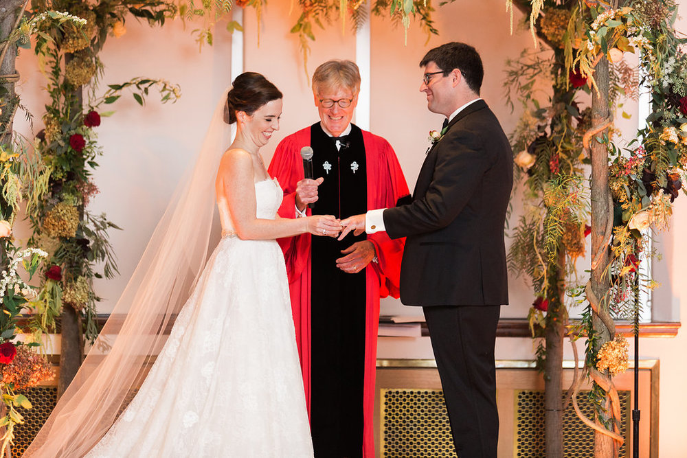 Winston's father officiated the ceremony which incorporated christian and jewish traditions. The chuppah structure was built by the groom and lavishly decorated by Evantine Design.