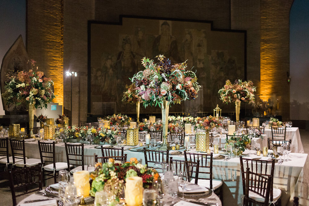 Guests were seated at long and round tables in the Chinese Rotunda in the museum. The centerpieces mirrored the fall tones of the flowers seen in the personal bouquets.