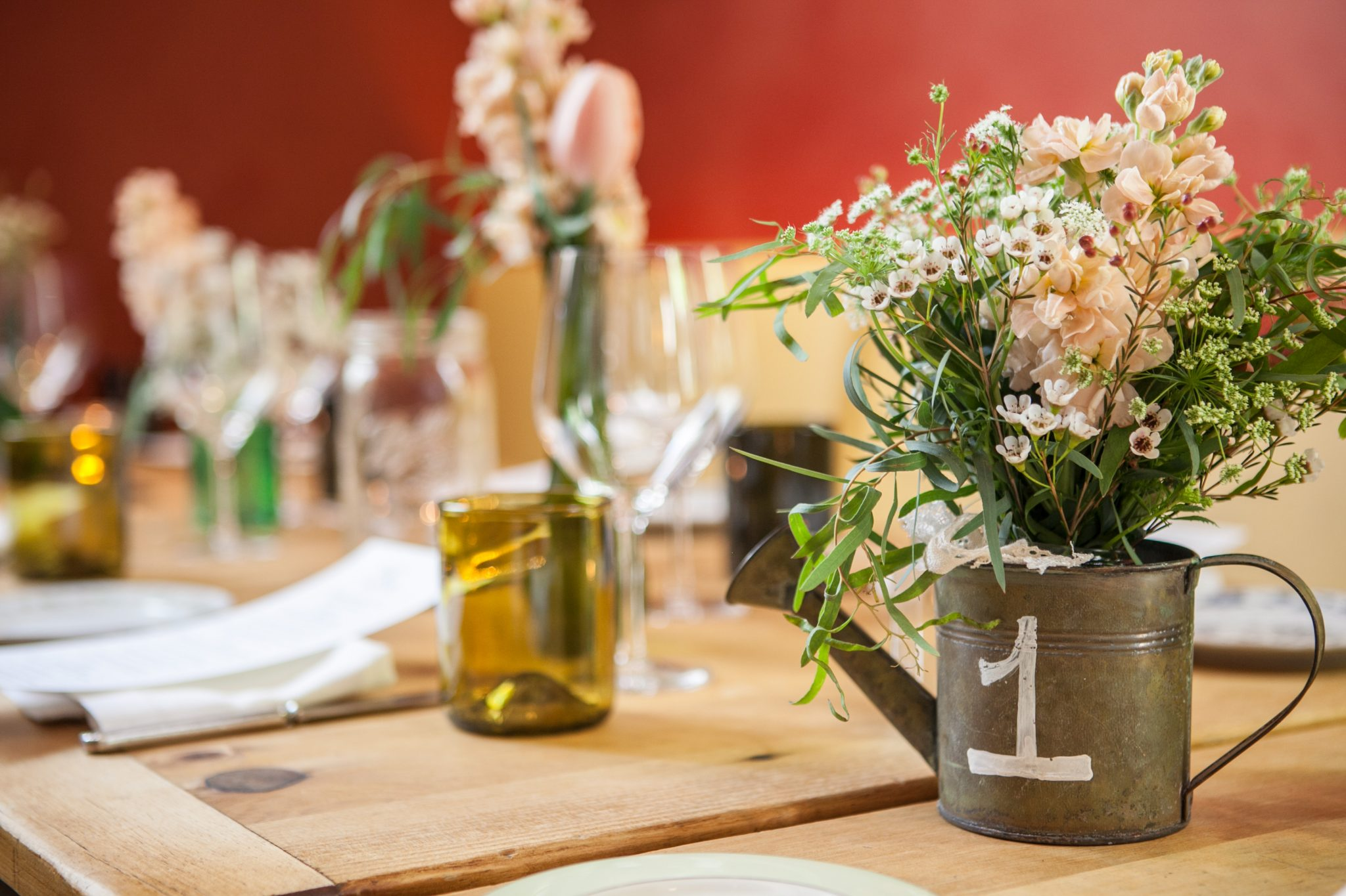 Sweet and simple centerpieces for a wedding at Talula's Garden. | www.TheStyledBride.com